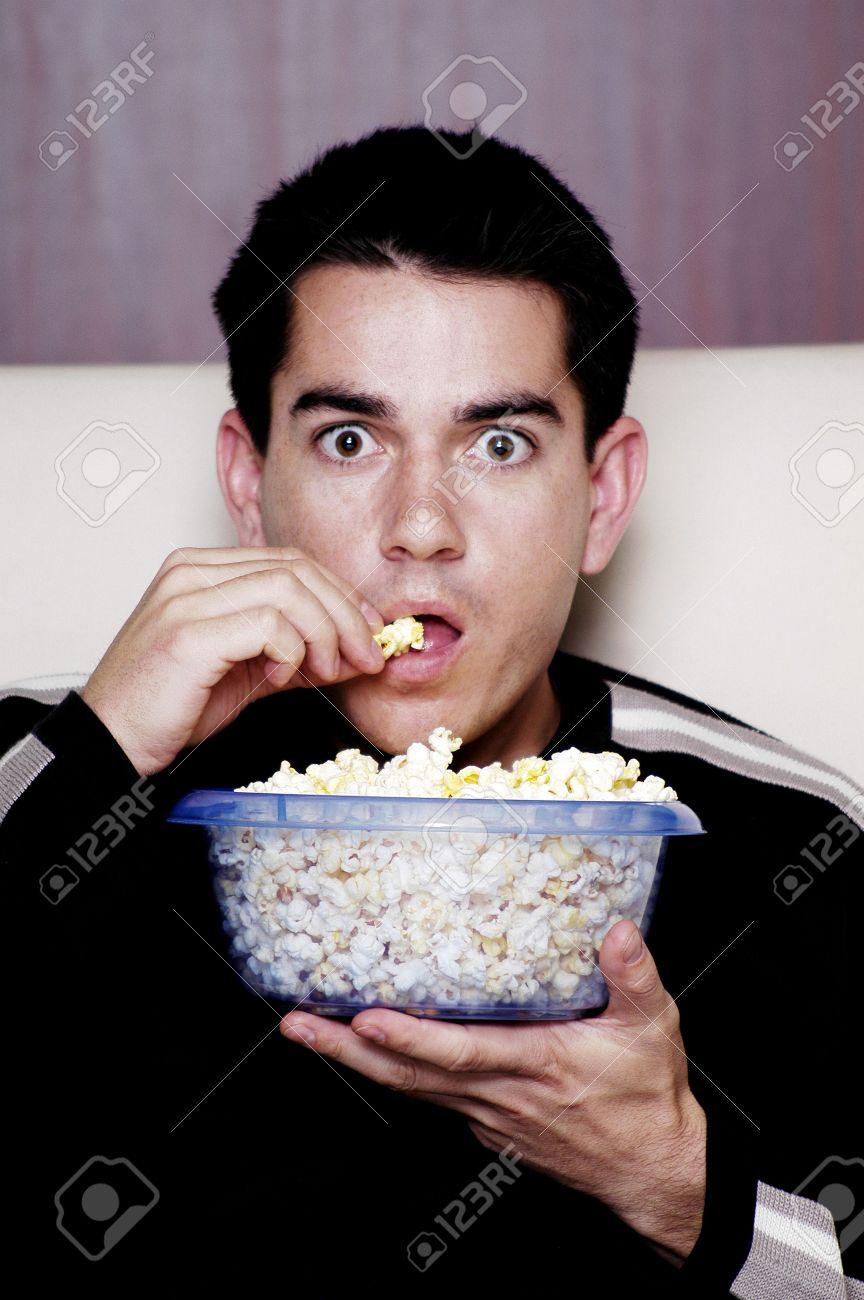 Name:  3192526-Man-eating-popcorn-while-watching-movie--Stock-Photo.jpg Views: 202 Size:  118.2 KB