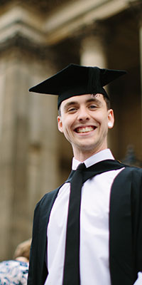 A graduate celebrates getting his degree