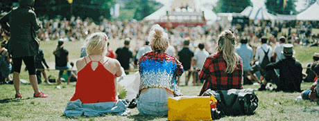 Students sitting at a festival