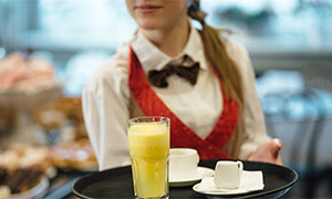 Waitress serving drinks