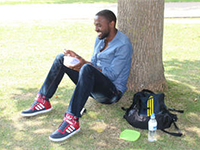 A student relaxing on the grass