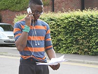 A student on the phone trying to get a uni place through Clearing