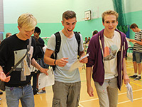 Three students receiving their GCSE results