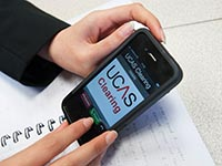 A student using their phone to find Clearing opportunities
