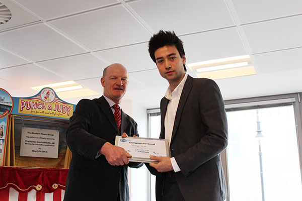 Michael Smith, nominee in the Against All Odds category of the TSR Student in a Million awards, receives his certificate from David Willetts.