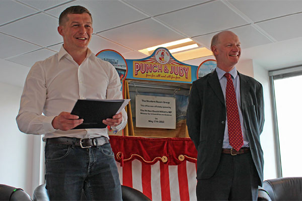 David Willetts, minister for universities and science, opens the new office of The Student Room by unveiling a plaque within Punch and Judy tent!