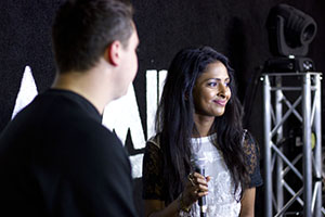 File:Mischelle interviewed the bands in the artists' area behind the main stage Resized.jpg