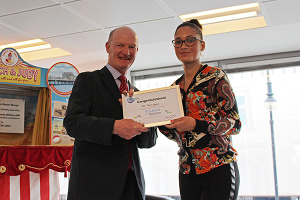 Ria Sarrington, nominee in the Against All Odds category of the TSR Student in a Million awards, receives her certificate from David Willetts.