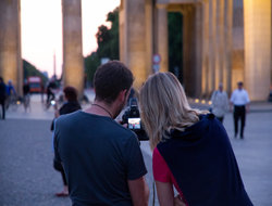 File:Couple with camera.jpg