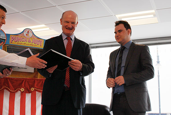Jake Haven, nominee in the Against All Odds category of the TSR Student in a Million awards, receives his certificate from David Willetts.