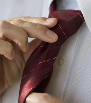File:Adjusting tie.jpg