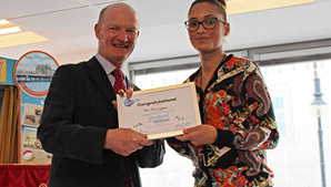 Ria Sarrington being presented with her award by David Willetts at The Student Room's 2013 Student in a Million awards ceremony