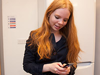 File:Student-making-a-phone-call-to-a-uni-in-adjustment.jpg