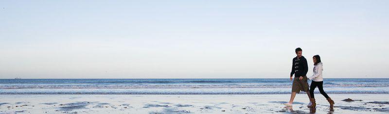 File:2 students walking along beach (2).jpg
